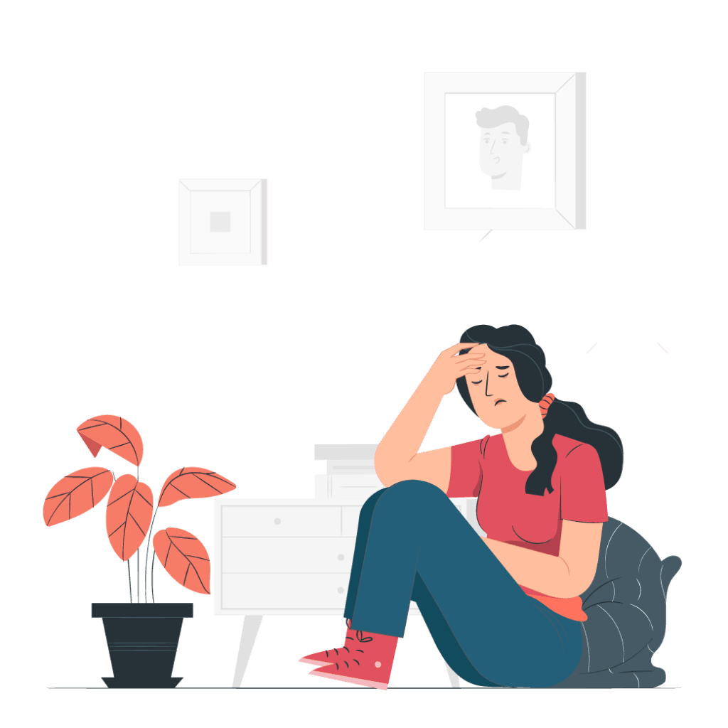 a women sits in front of a plant dealing with the pain of a headache
